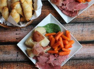 Slow-cooked a corned beef brisket with red potatoes, carrots and crescent rolls