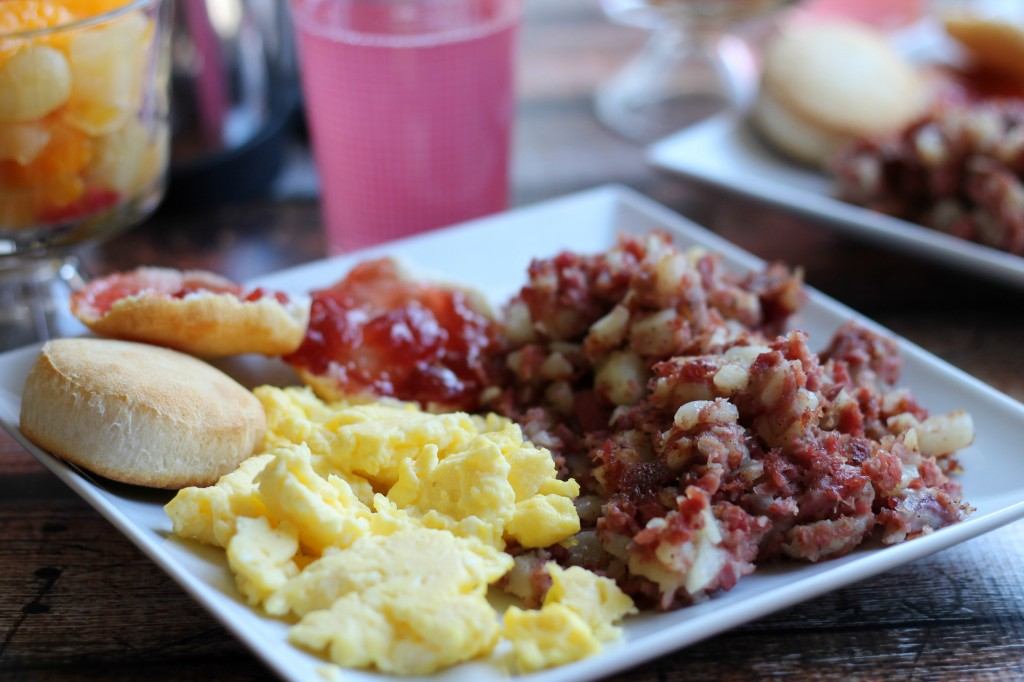 Corned beef hash with eggs and a biscuit