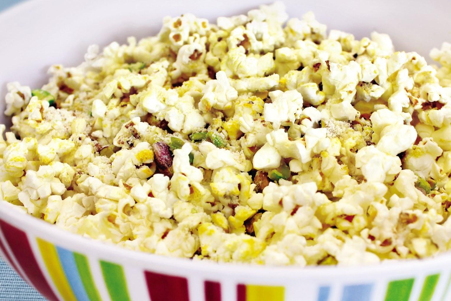 Lemon parmesan popcorn with pistachios in a bowl.