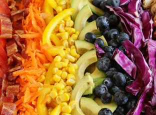 Various ingrediends for Rainbow Cobb Salad laid out to create a rainbow