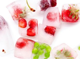 Ice cubes with assorted fruit inside of them