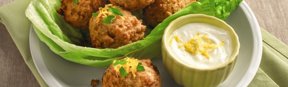Plated artichoke fritters with dipping sauce