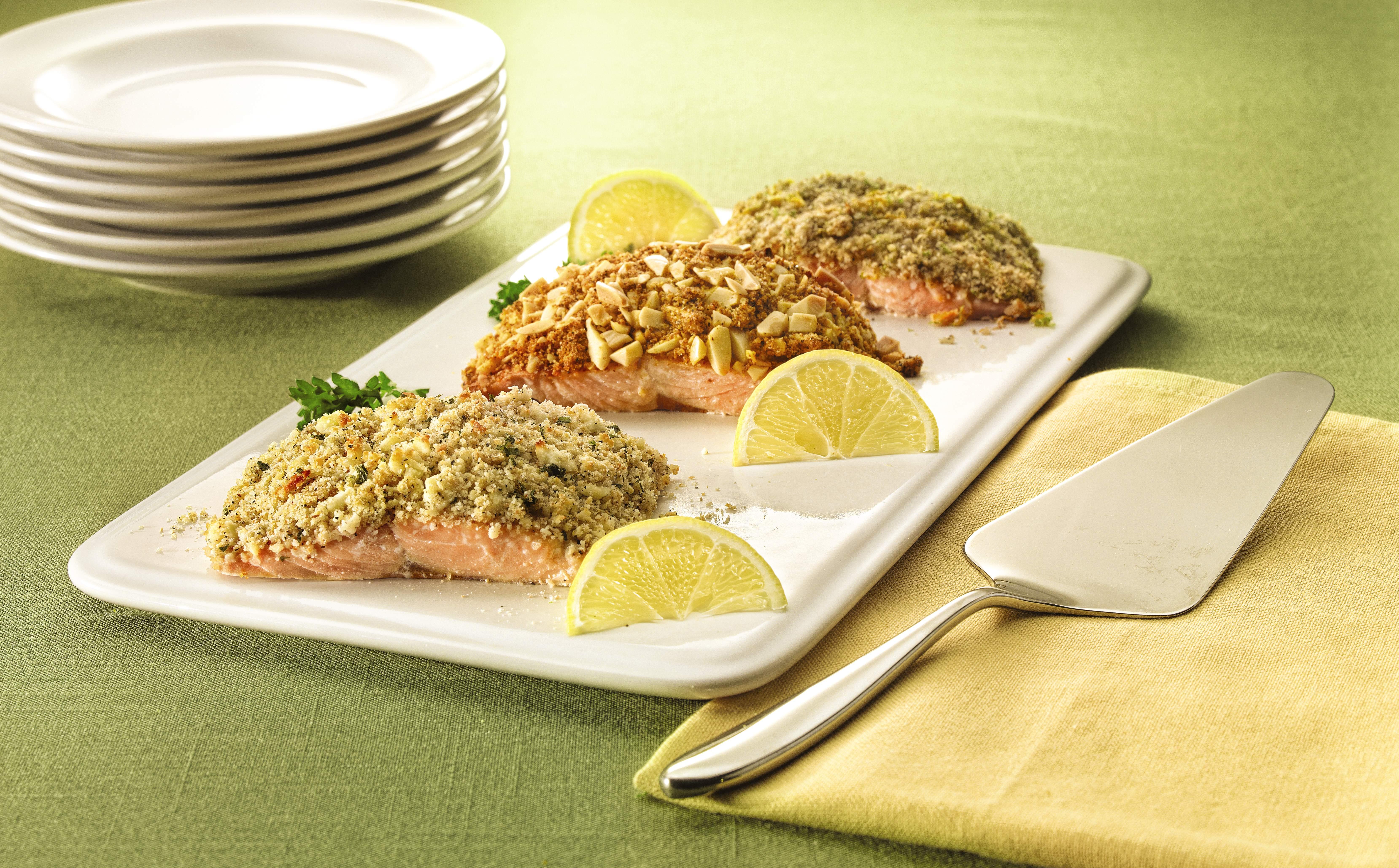 Crusted salmon with lemon and parsley garnish.