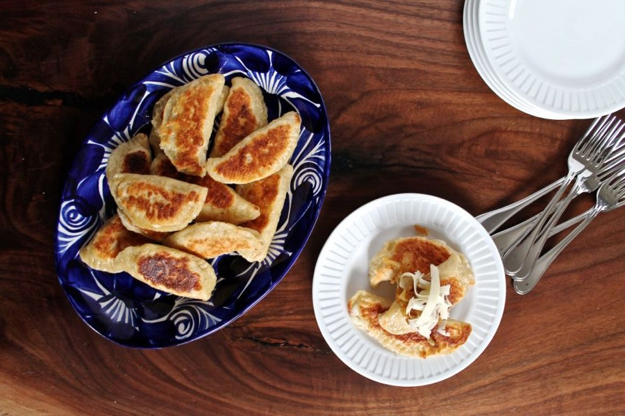 Plated pierogis with onions