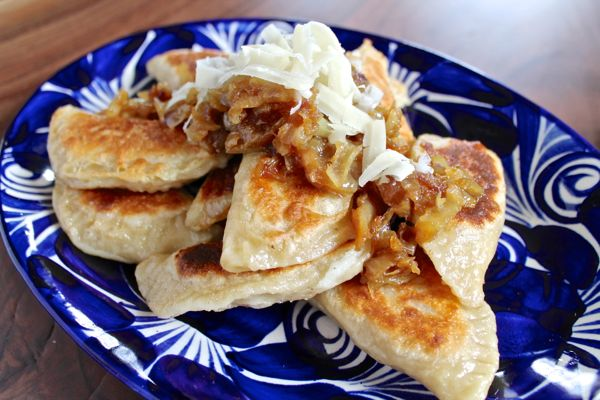 Plated pierogi with onions