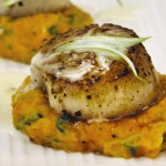 Brown butter scallops on sweet potato puree.