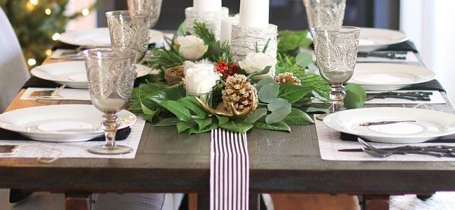 Beautiful tablescape for Christmas dinner in front of the fireplace and tree.