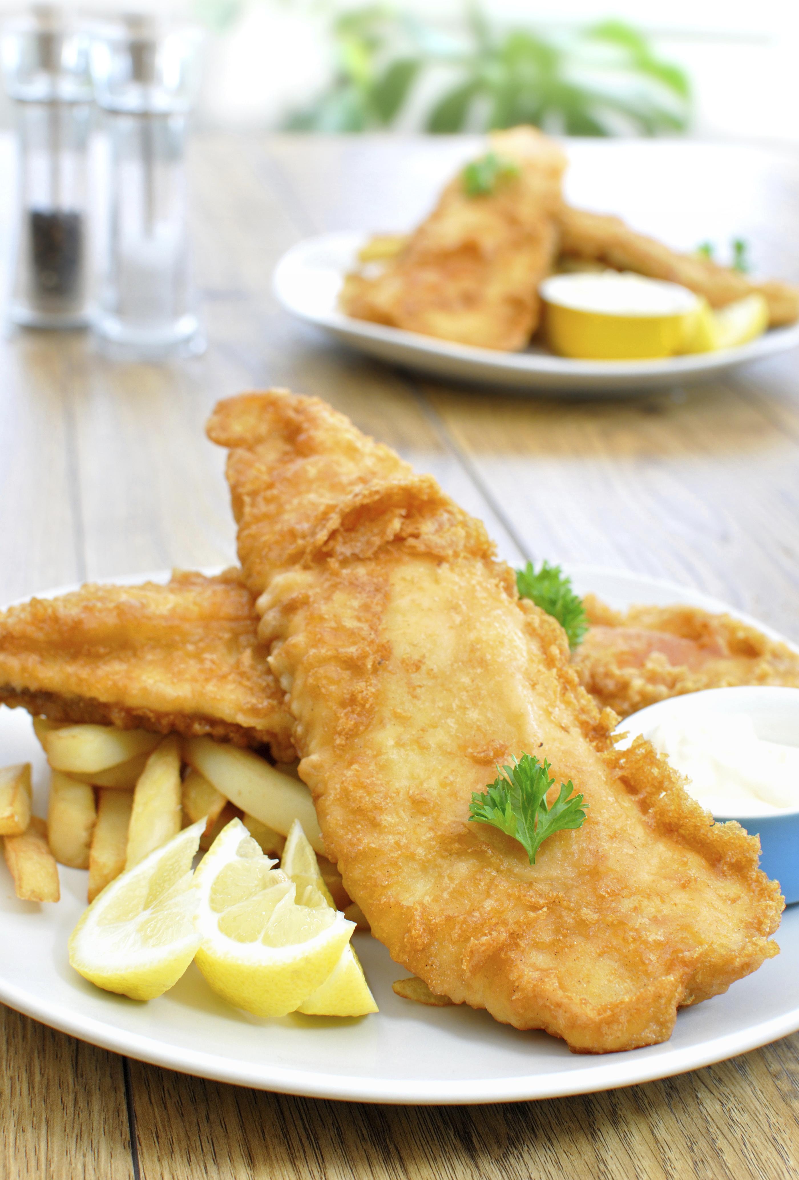 Traditional English fish and chips with lemon garnish and tartar sauce