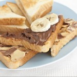 Toast with hazelnut spread and bananas.