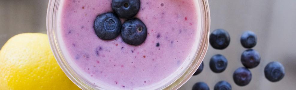 Lemon blueberry smoothie with fresh blueberry garnish.