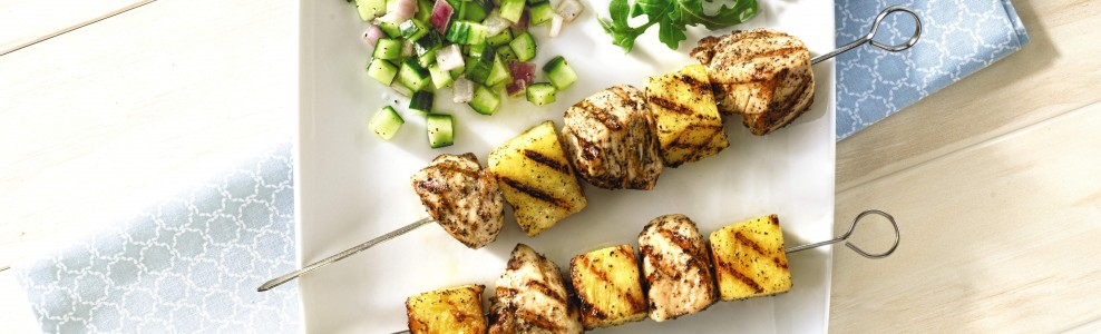 Grilled chicken and pineapple skewers with cucumber lemon salsa and arugula.