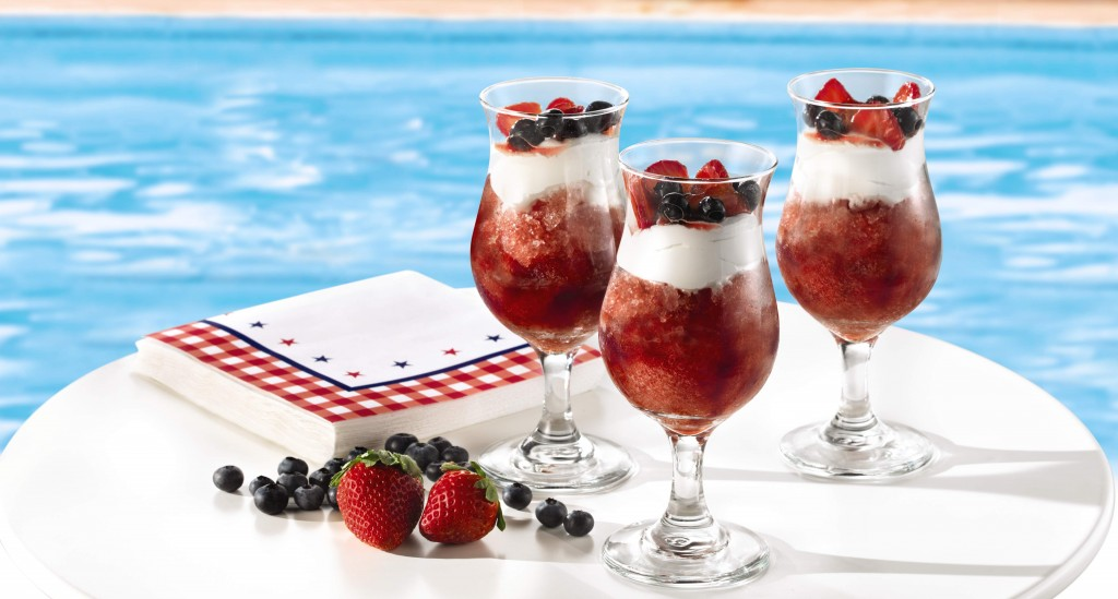 Star spangled slush made with sangria and fresh fruit garnish.