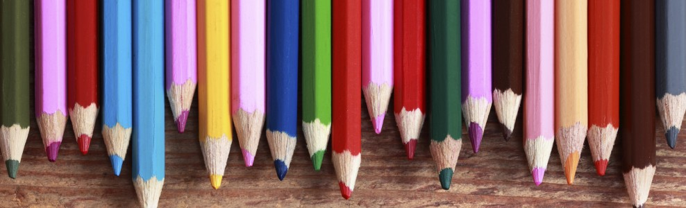 Various colored pencils in a row.