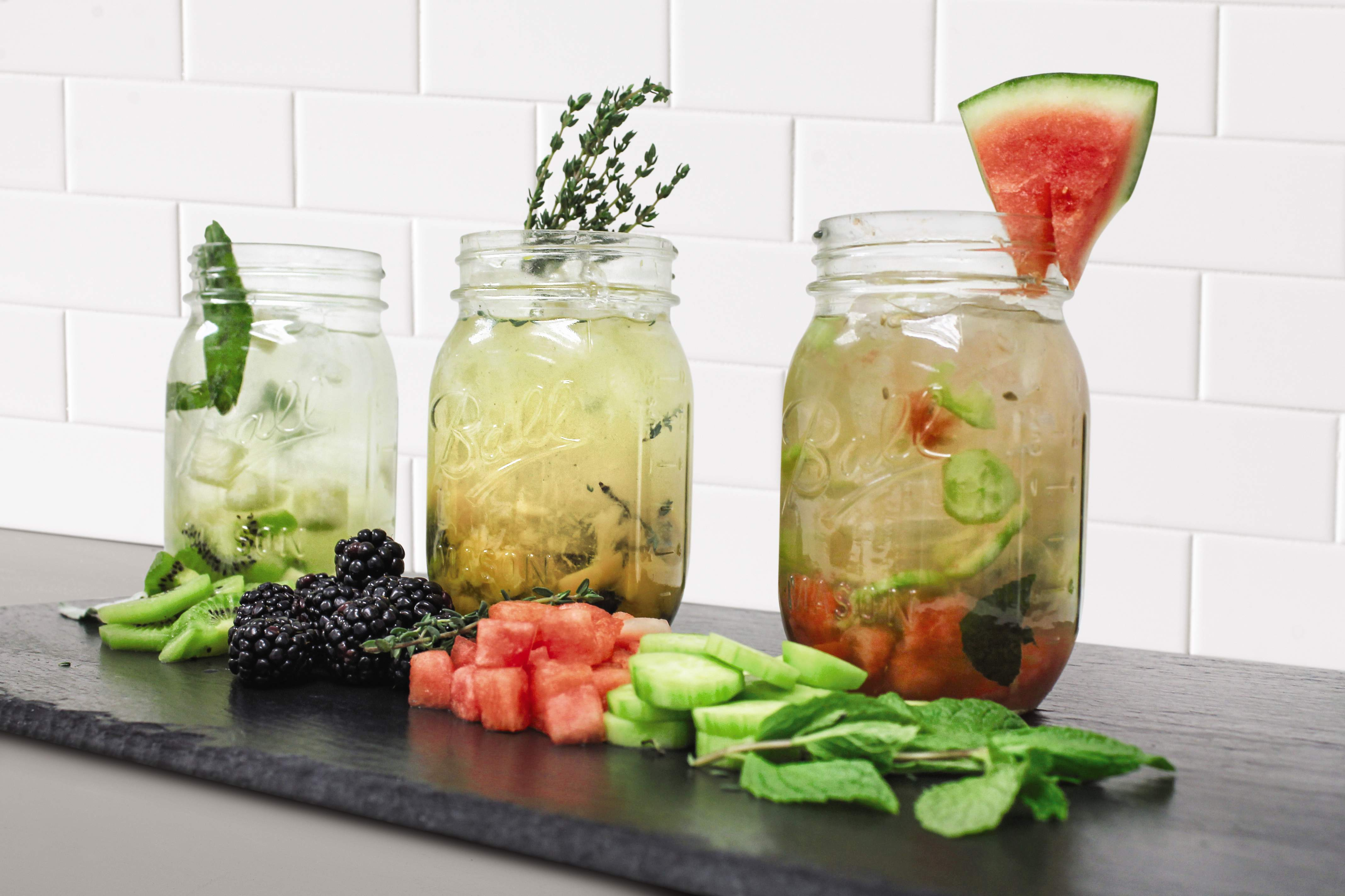 Fruit infused waters with garnishes.