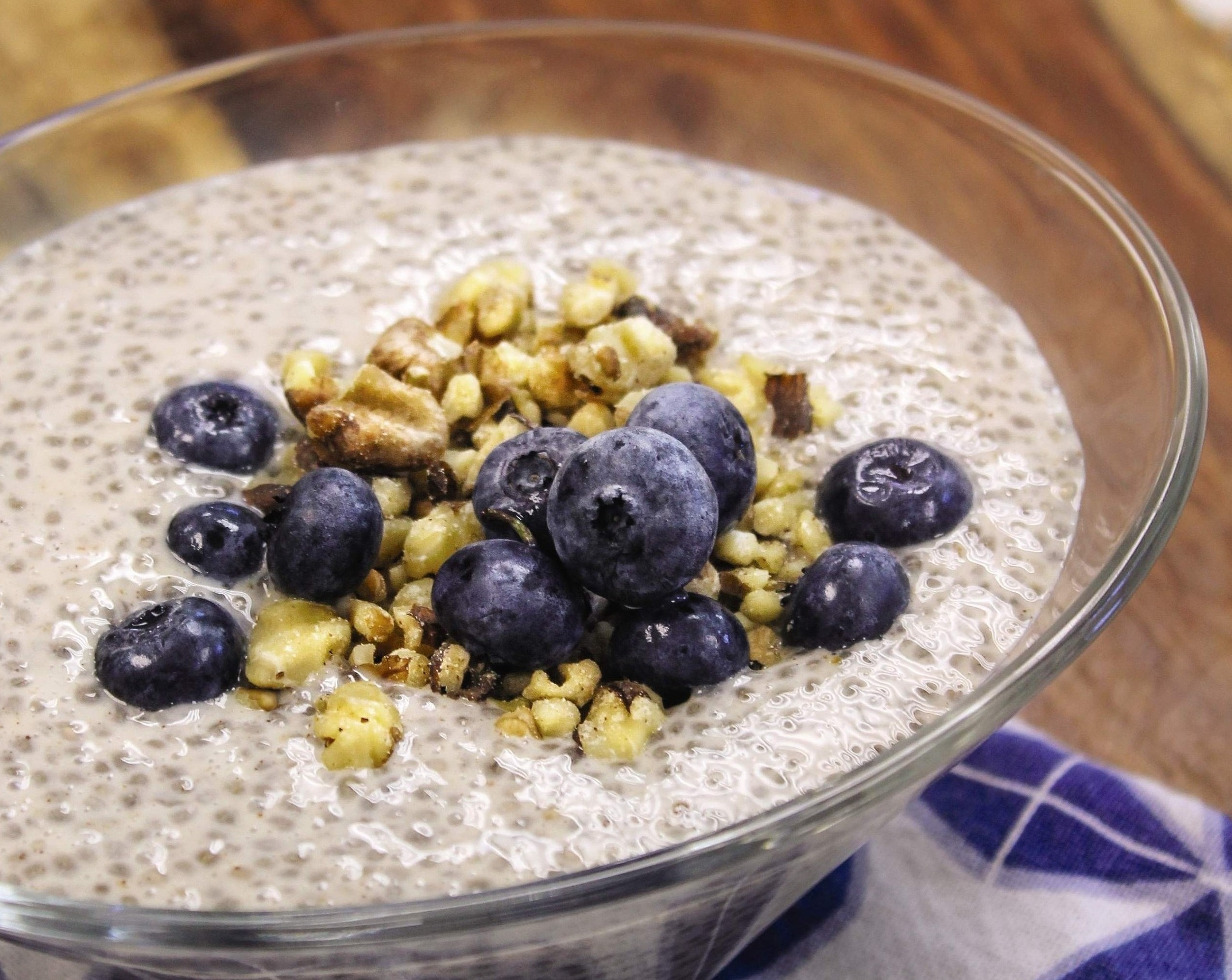 Chia pudding topped with fresh blueberries and walnuts.
