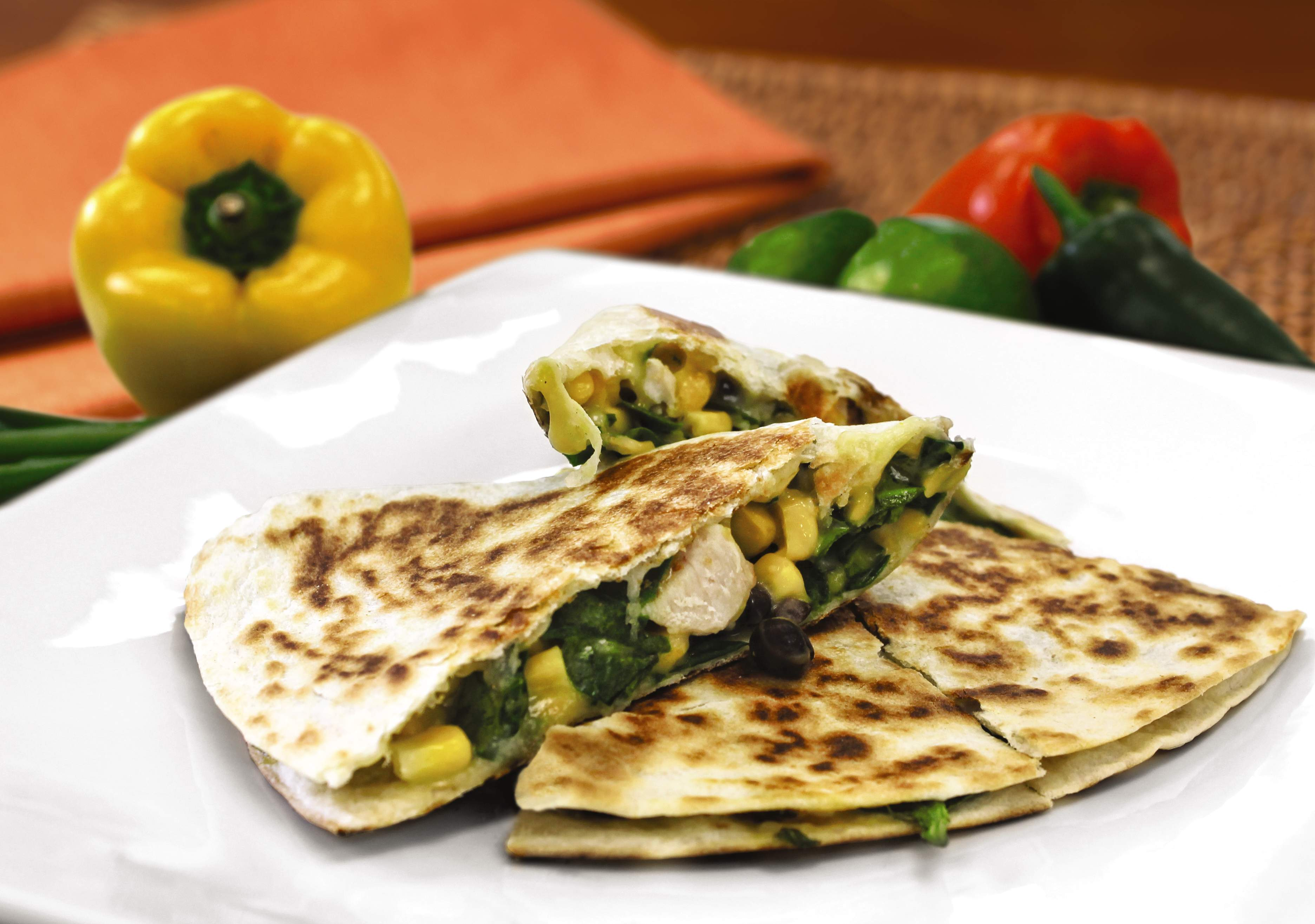 Southwestern chicken quesadilla with black beans and spinach.