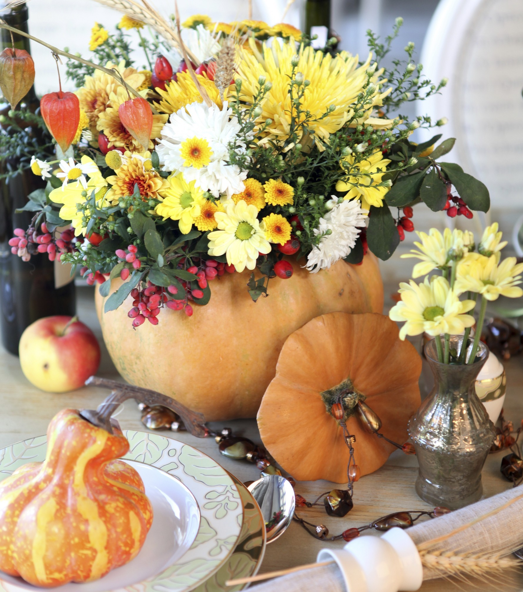 Pumpkin filled with cut flowers used as a centerpiece.