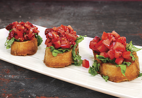 Bruschetta with crusty bread, basil, and tomatoes.