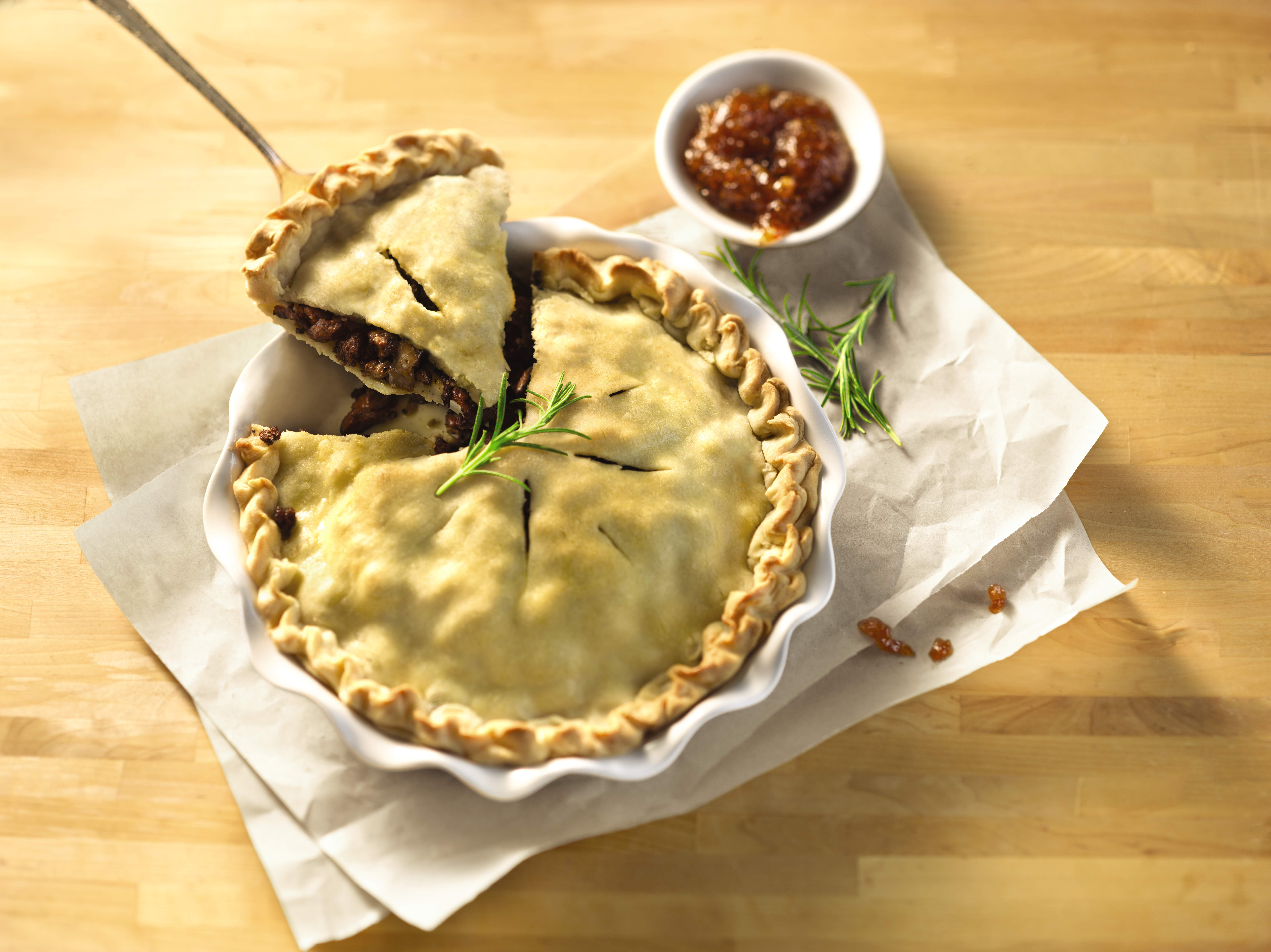 Savory meat pie with beef, pork, and mushrooms.