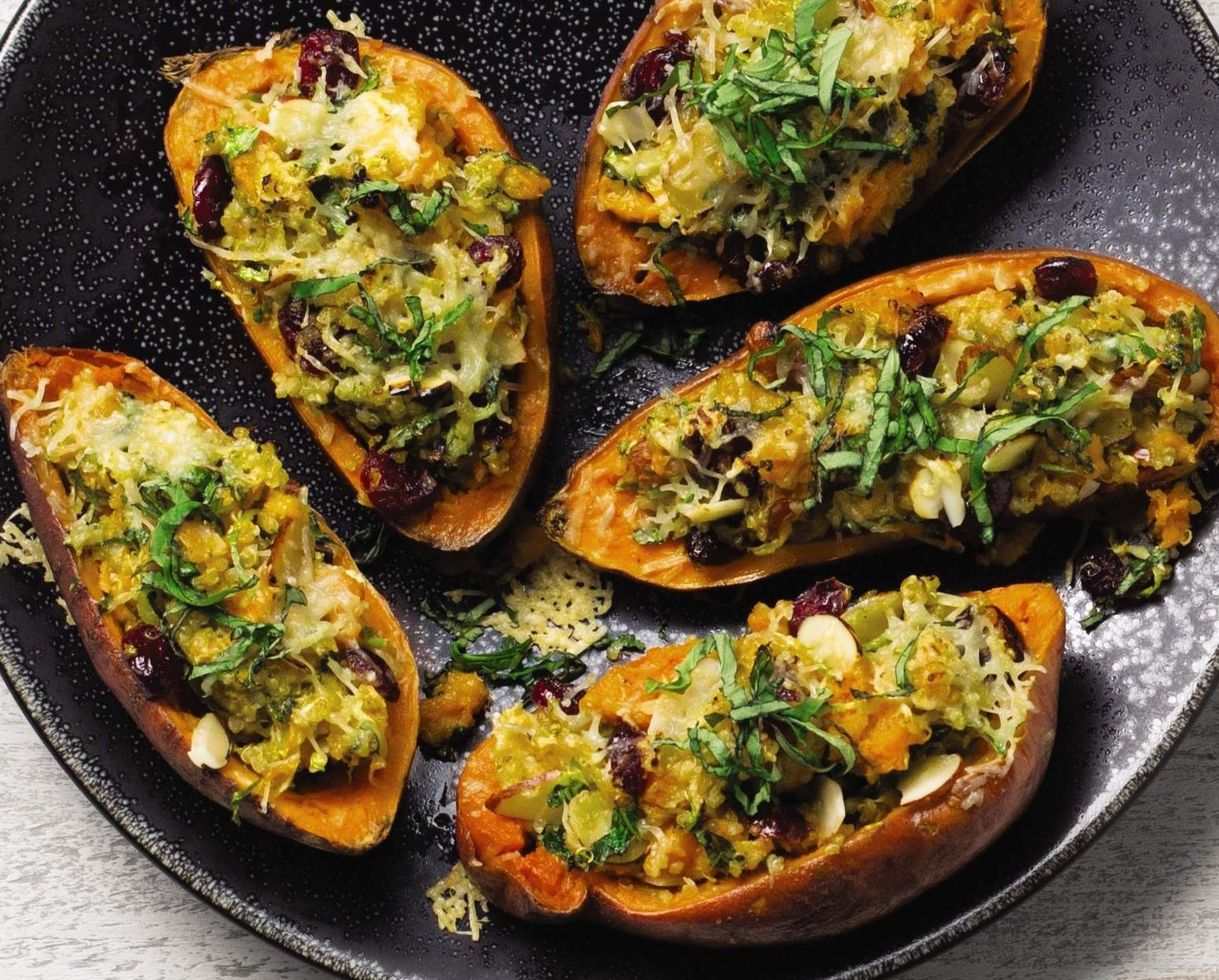 Sweet potatoes stuffed with quinoa and veggies.