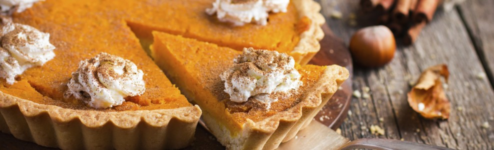 Pumpkin pie with cinnamon spiced whipped cream.
