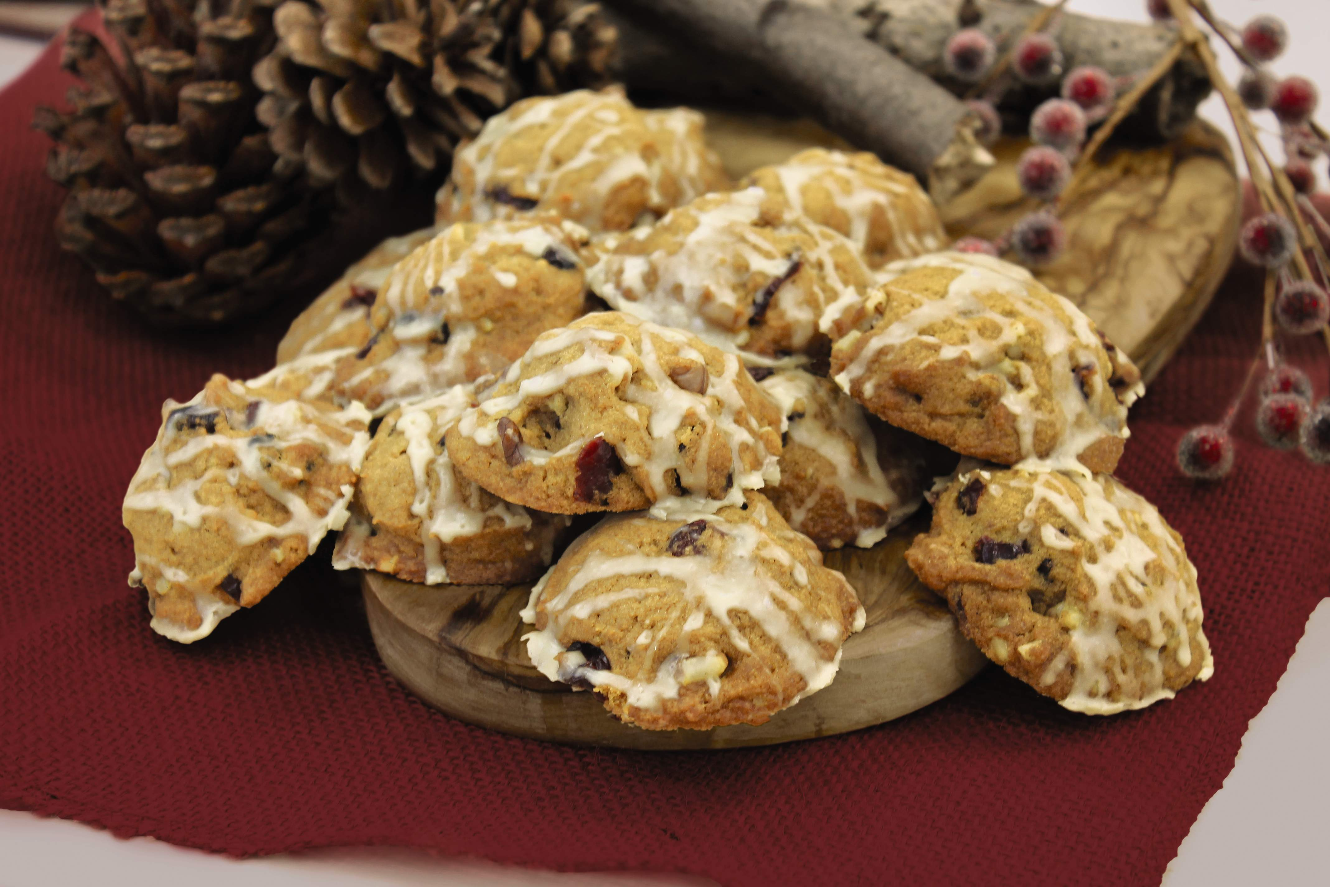 Pumpkin cranberry walnut cookies with maple glaze.