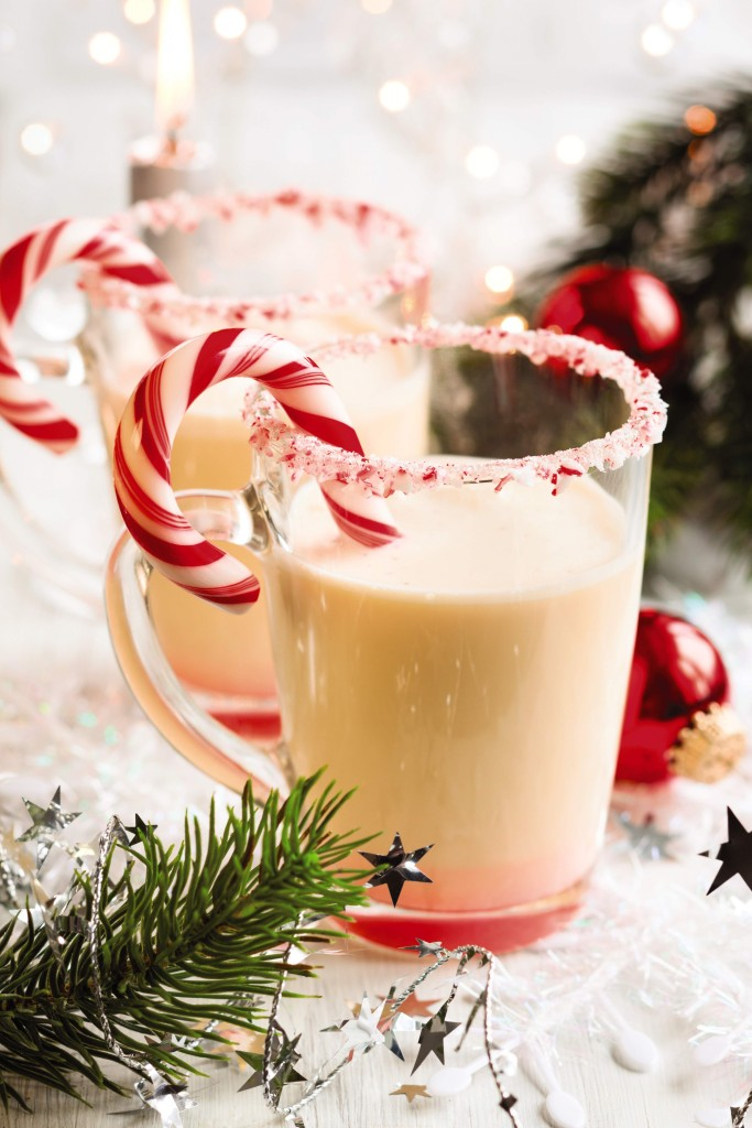 A glass full of Irish peppermint milkshake with a candy cane garnish.