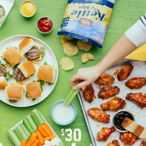 A spread of ALDI party foods under $30 including Grass Fed Beef, chicken wings and kettle cooked chips.