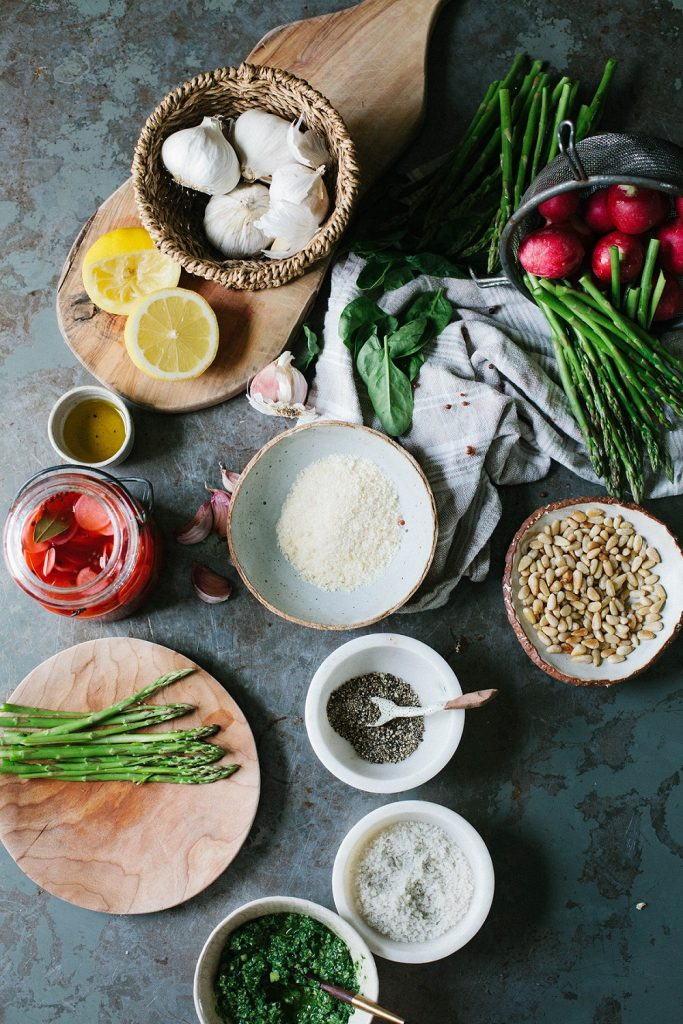 An array of fresh ingredients for meal prep including asparagus and garlic.
