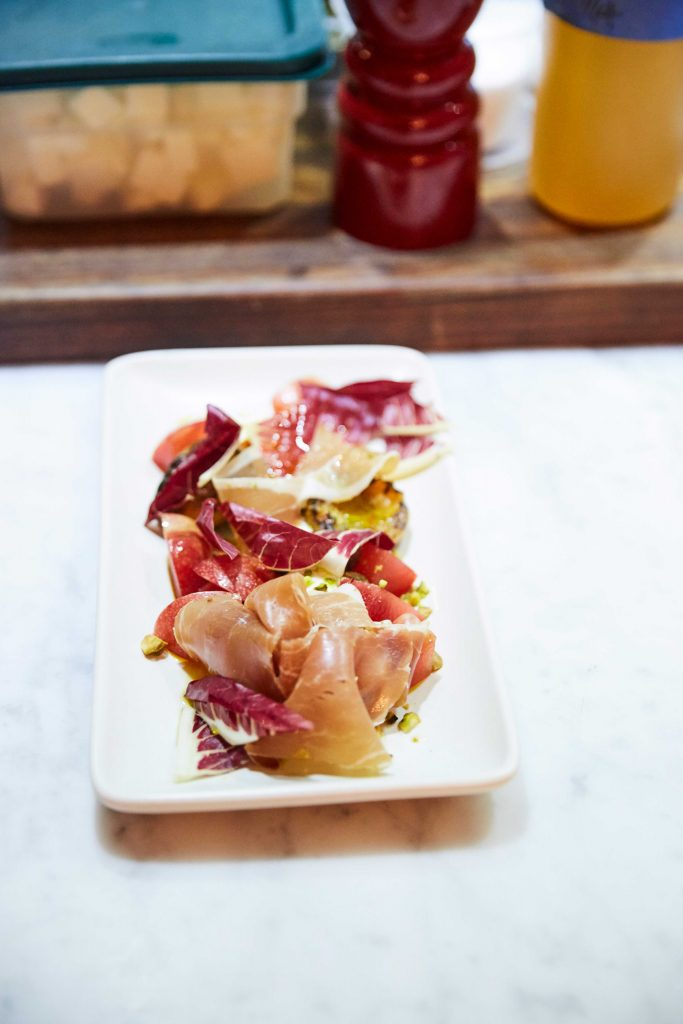 A prosciutto salad on a serving dish.