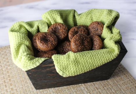 A basket full of Double Chocolate Protein Muffins.