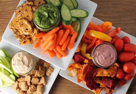 Three varies of dip and snacks including Spicy Chili Lime Cashew Dip, Avocado Arugula Dip and Peanut Butter Yogurt Dip.