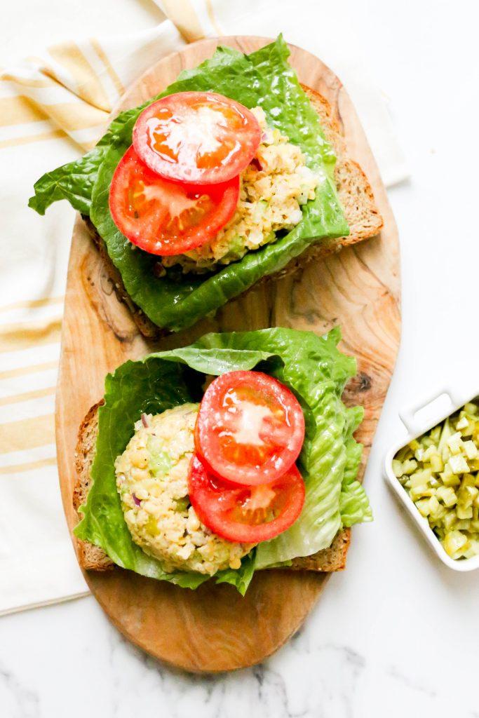 Tuna-less Sandwich served on a cutting board.