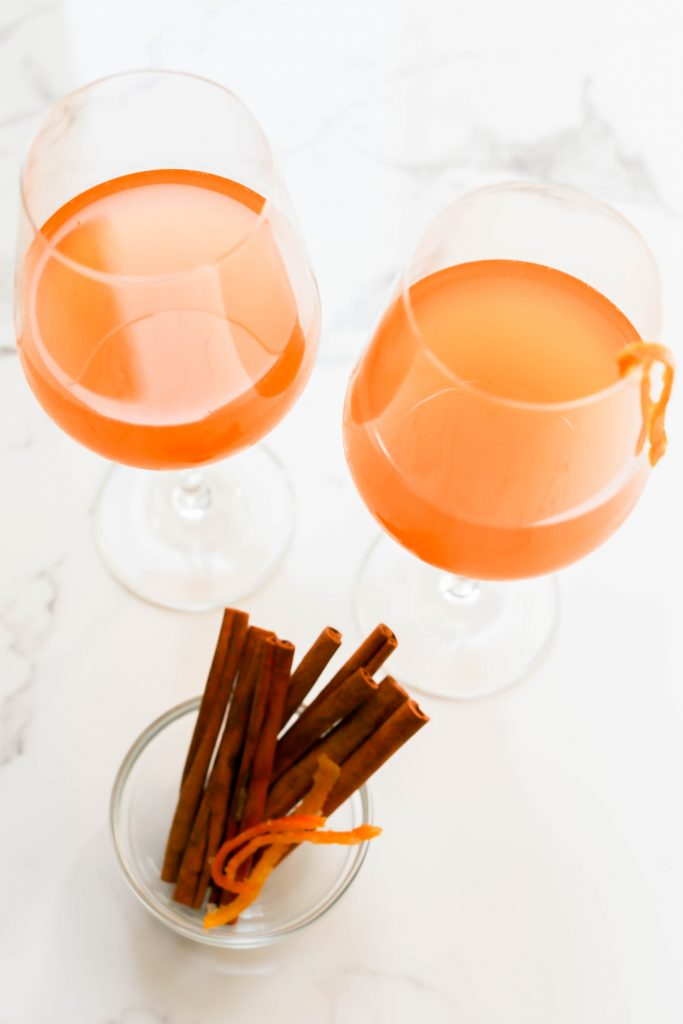 "Rosé ""Old Fashioned"" paired with fresh cinnamon sticks and orange peel for garnish."
