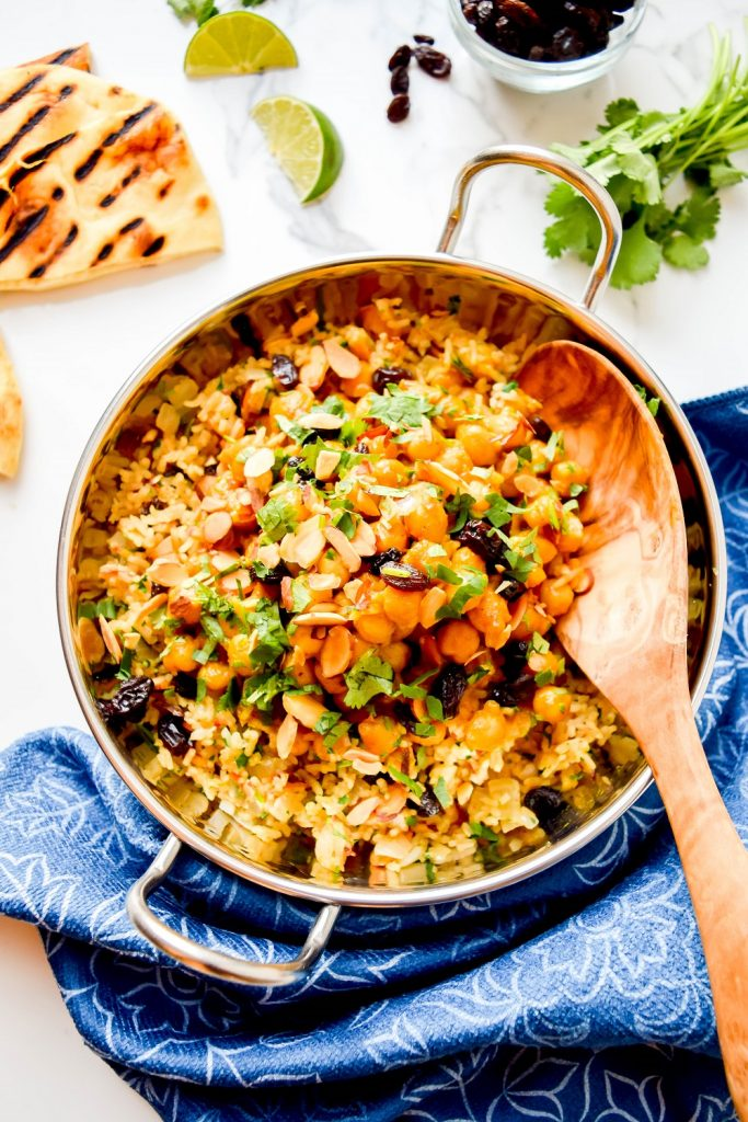 Chickpea Korma with Spiced Rice in a pan.