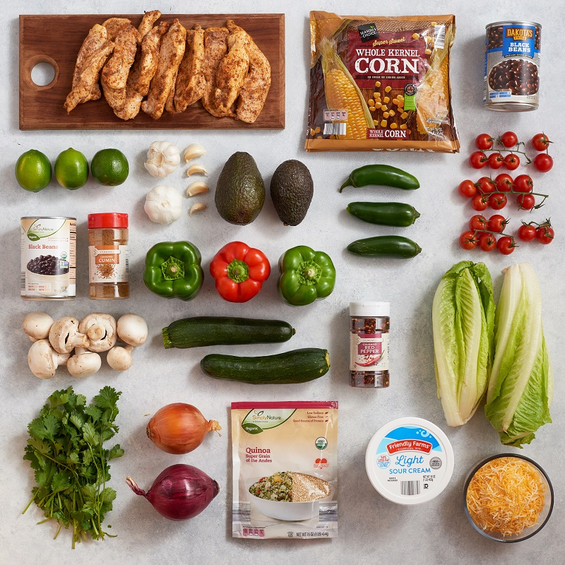 An overhead shot of ingredients needed for meal prepping Chicken Fajita Sheet Pan, Southwest Stuffed Peppers and Quinoa Burrito Bowl.