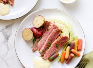 Corned Beef with Cabbage, roasted potatoes and colorful carrots.