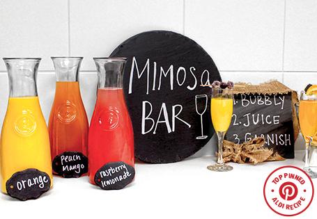 A mimosa bar with three flavors, orange, peach/mango and raspberry lemonade.