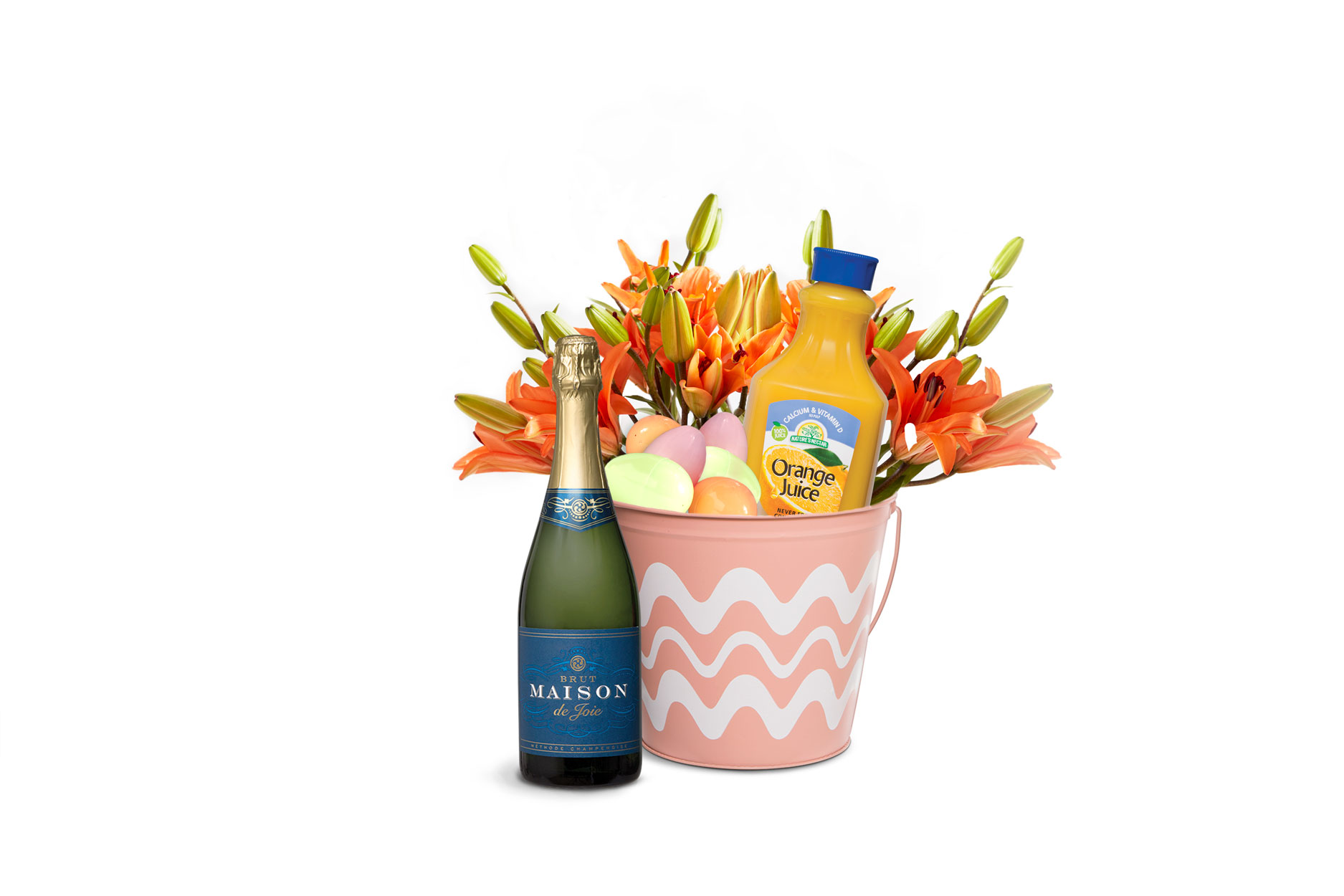 A brunch themed Easter basket with Maison de Joie Brut Sparkling, orange juice, and flowers.