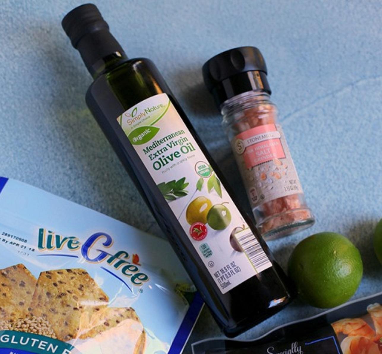 Mediterranean Extra Virgin Olive Oil next to Pink Himalayan salt.