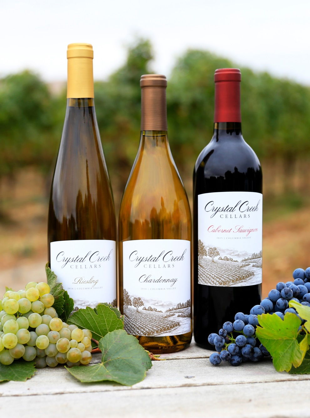 Three varieties of Crystal Creek Cellars beverages including Risling, Chardonnay and Cabernet.