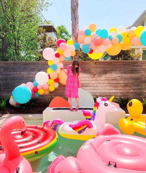 Selection of whimsical pool floats at a pool party.
