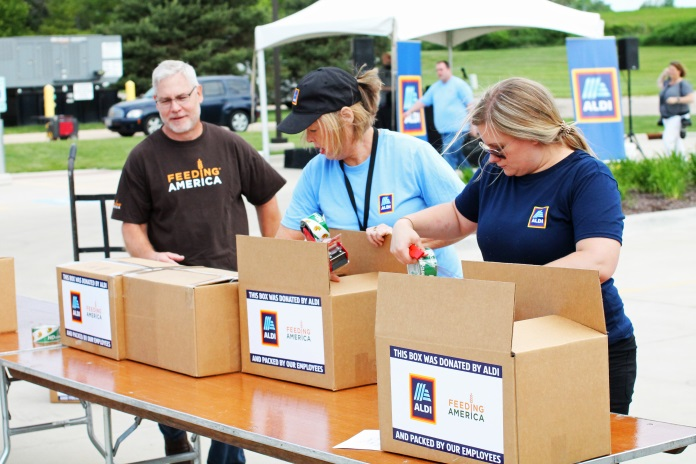 ALDI employees helping load boxes for Feeding America.