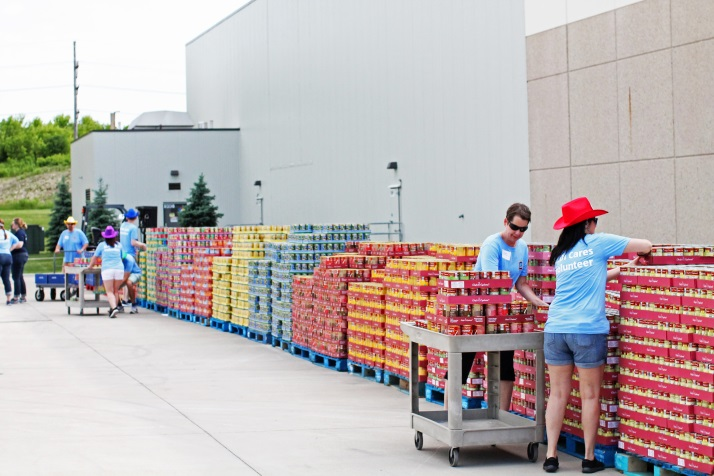 ALDI employees volunteering by helping organize cans.