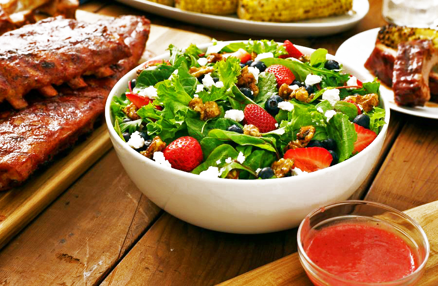 Summer berry salad with walnuts and fresh berries.