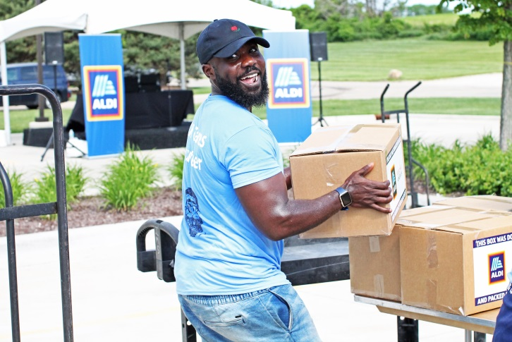 ALDI employee helping load boxes for Feeding America.