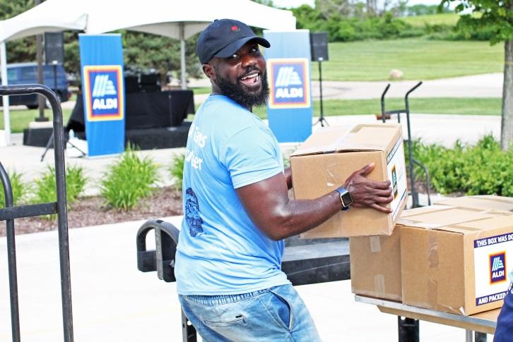 ALDI employee helping load boxes for Feeding America.