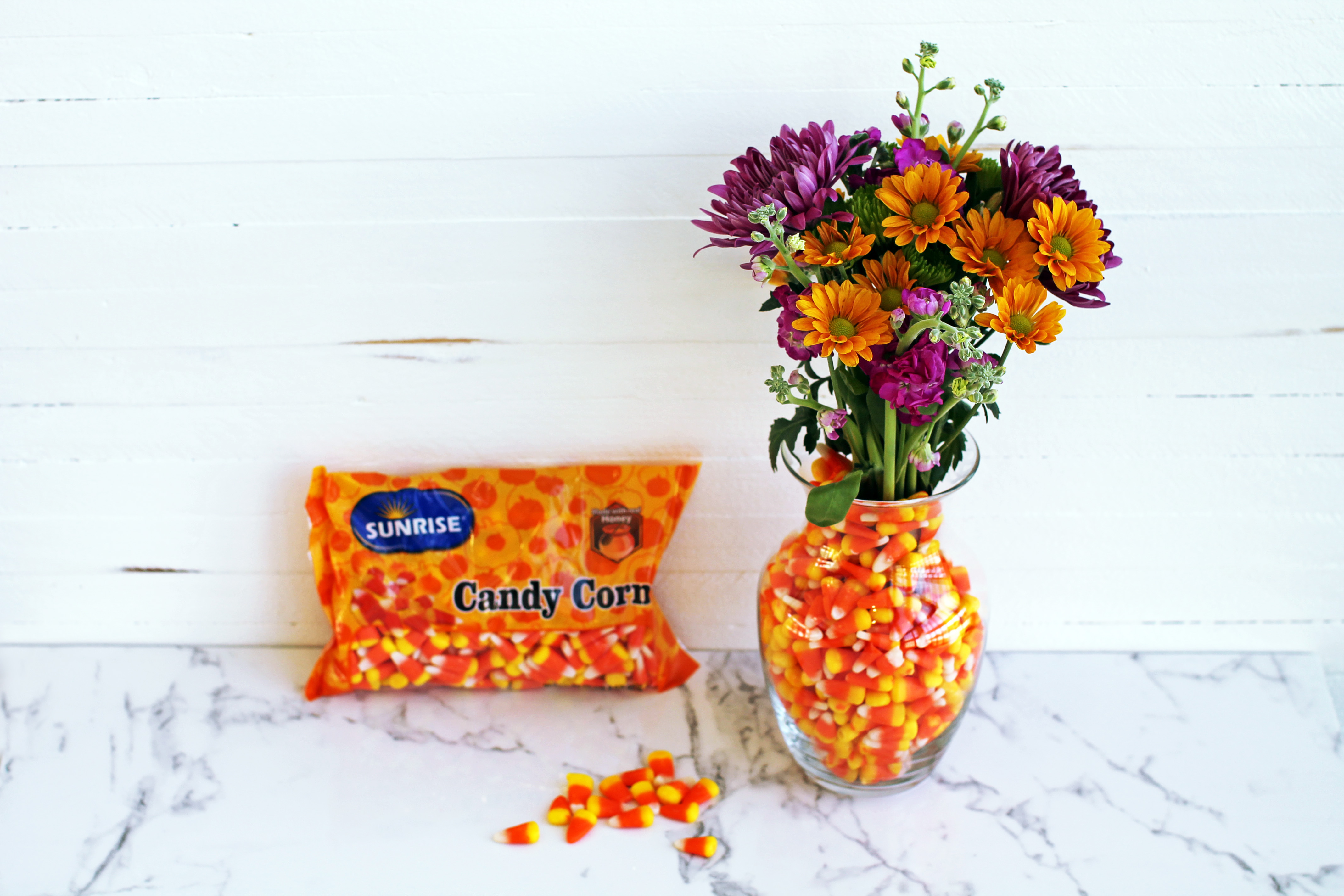 Vase decoration with candy corn and flowers.