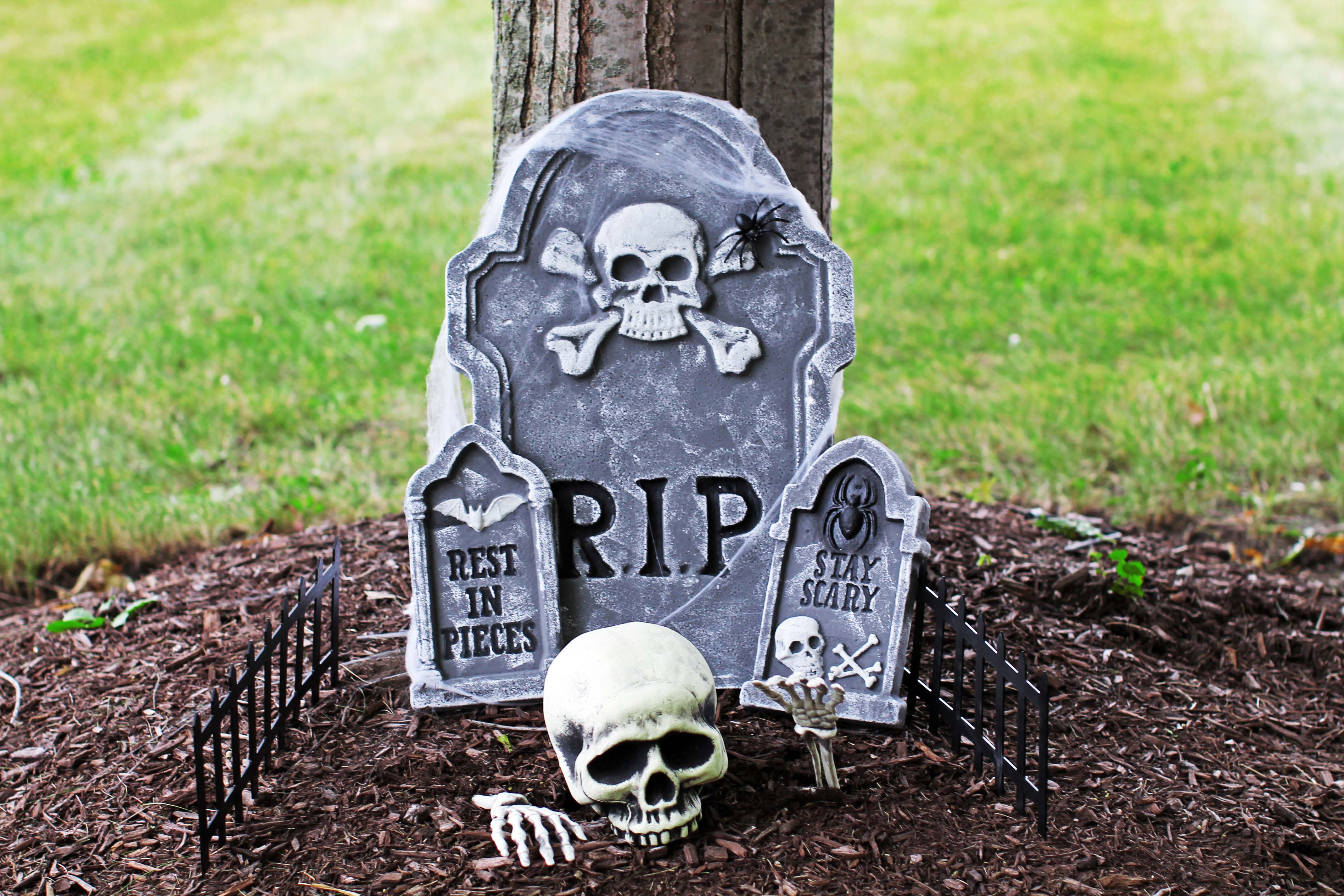 Tombstone ALDI find with skull.