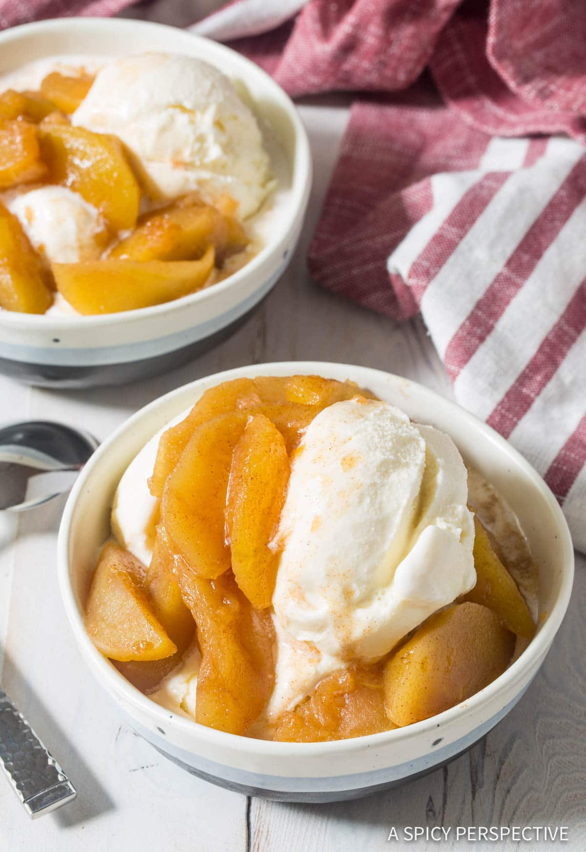 Spiced apples with ice cream.